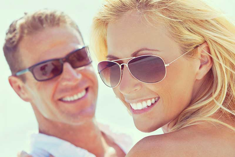 Happy couple in the sun with sunglasses