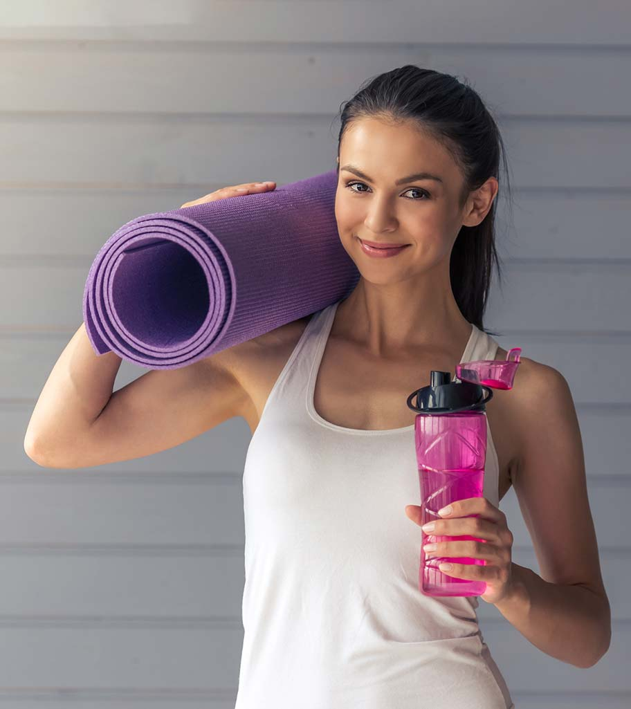 Smiling woman going to yoga class