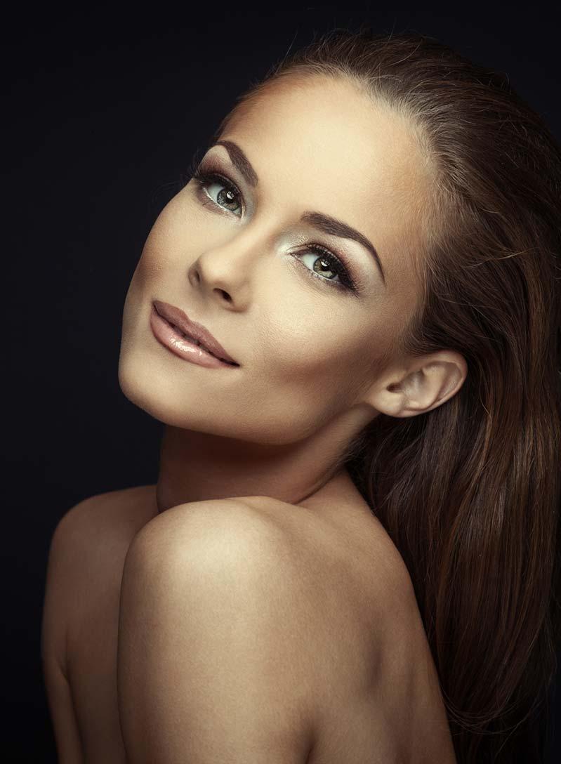 Beautiful woman glowing in smooth skin