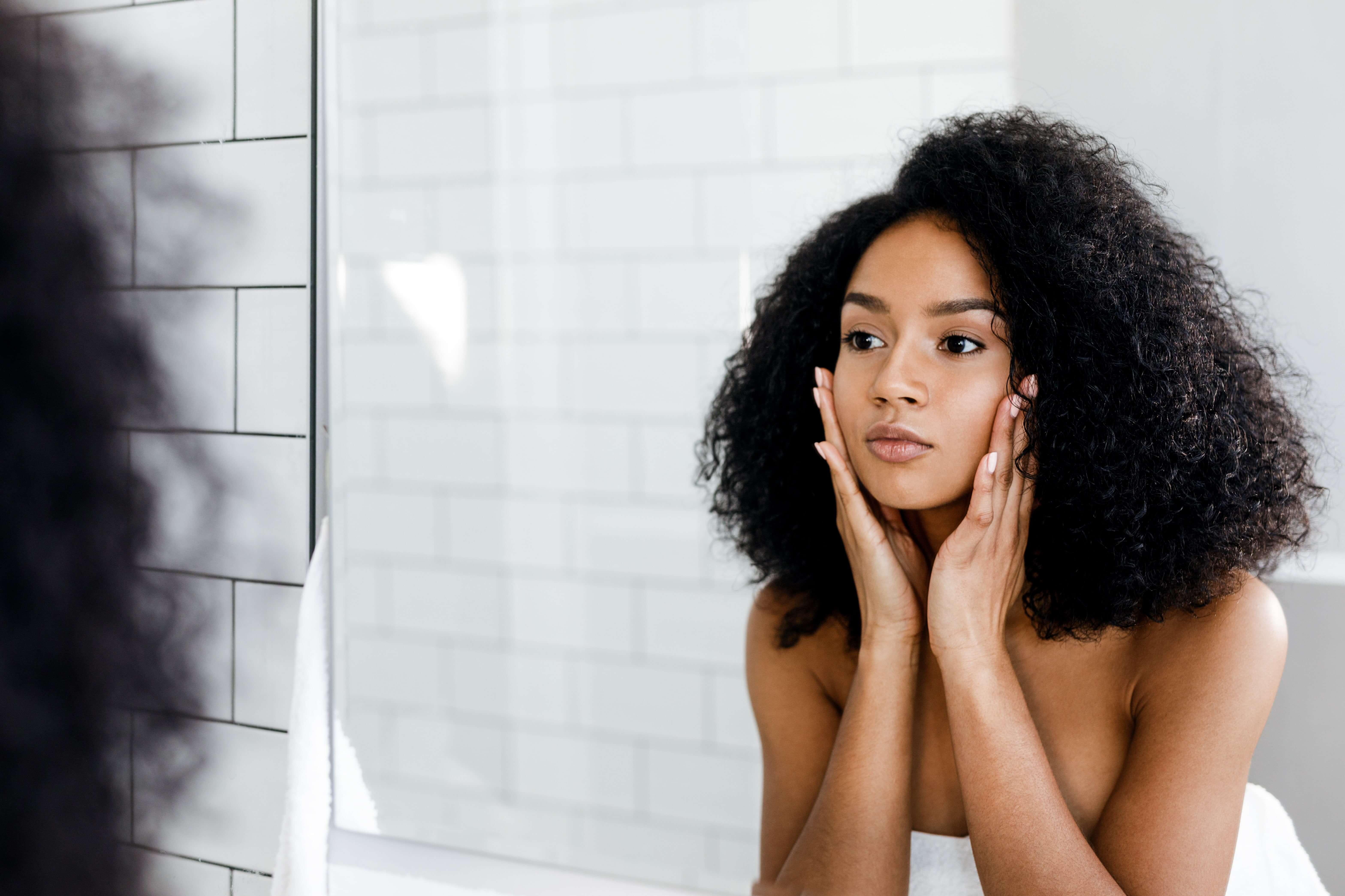 Girl Looking into Mirror